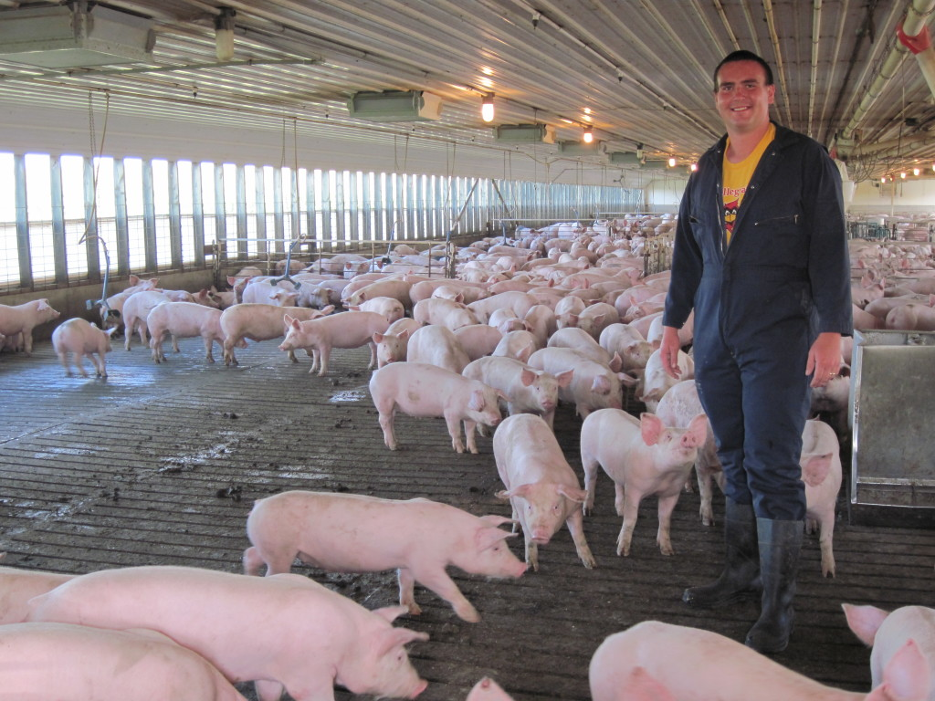 Val Plagge - Ian posing with hogs
