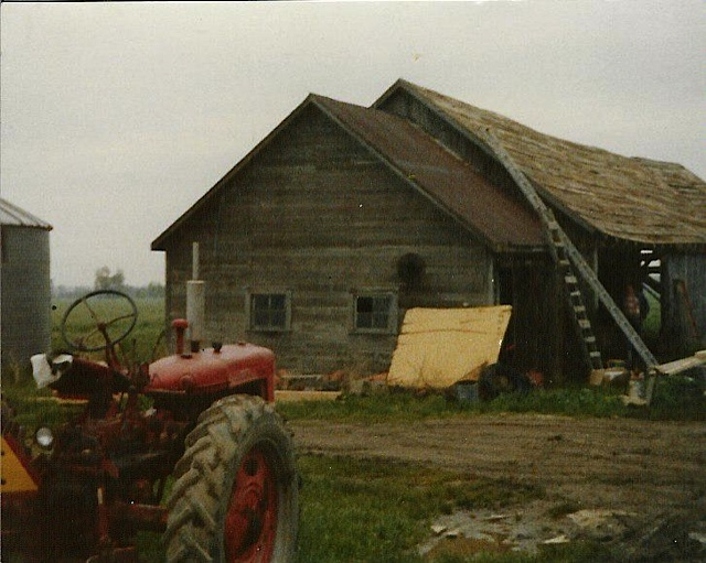 Photo from when I was in high school, I used to drive that old tractor, 10 hrs a day.